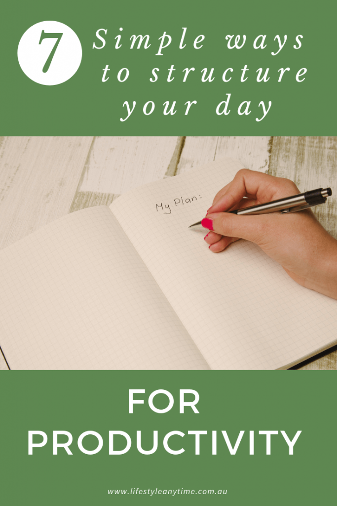 Writing out my plan in a note book with the 7 simple ways to structure your day for productivity.