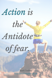Lady celebrating success on climbing a mountain for action is the antidote of fear.